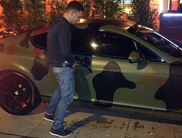 Footbal fan takes a leak on Mario Balotelli's car