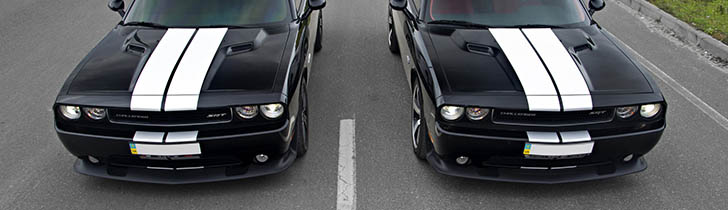 Two Dodge Challengers next to each other