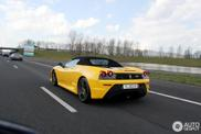 Yellow Ferrari Scuderia Spider 16 in the middle of an exclusive combo