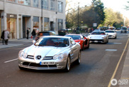 Group of supercars is driving through London