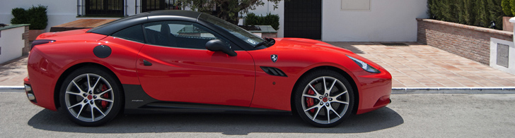 Black-red Ferrari California burning in the sun