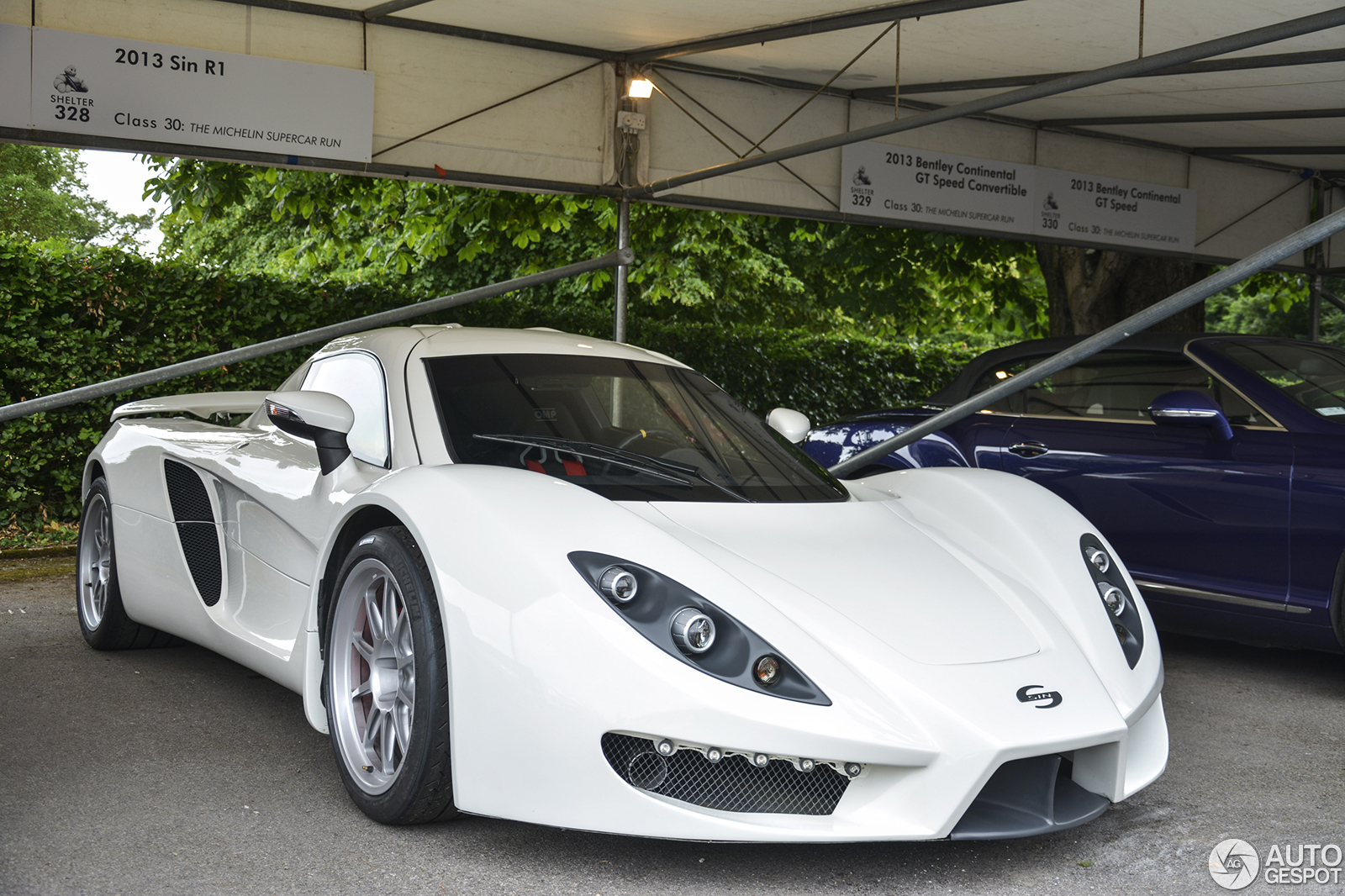http://log.autogespot.com/07-2013/goodwood_2013/sin_r1/1.jpg?last_change=1384335868